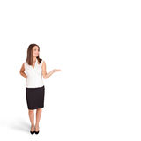 Young woman presenting white copy space Royalty Free Stock Image
