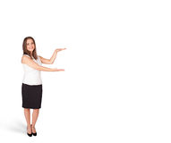Young woman presenting white copy space Royalty Free Stock Photo