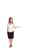 Young woman presenting white copy space Stock Photos
