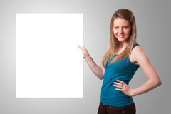 Young woman presenting white paper copy space Royalty Free Stock Image