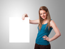Young woman presenting white paper copy space Stock Image