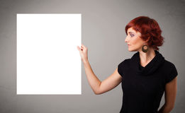 Young woman presenting white paper copy space Royalty Free Stock Photography