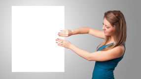 Young woman presenting white paper copy space Stock Photography