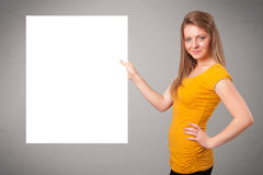 Young woman presenting white paper copy space Royalty Free Stock Photos
