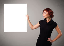 Young woman presenting white paper copy space Stock Images
