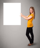 Young woman presenting white paper copy space Royalty Free Stock Photo