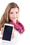 Young woman presents her cell phone Royalty Free Stock Photography