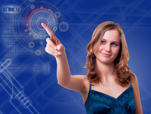 Young woman presses the button. On the high-tech screen Stock Image