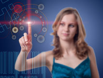 Young woman presses button on the high-tech screen. Young woman presses the button on the high-tech screen Stock Photo