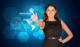 Young woman pressing on holographic screen Royalty Free Stock Photo