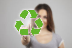 Young woman pressing recycle icons Stock Photos