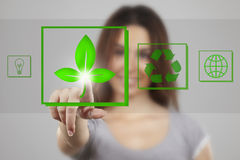 Young woman pressing recycle icons Stock Images