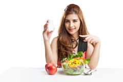Young woman pretty attractive presenting blank bottle supplement Stock Images