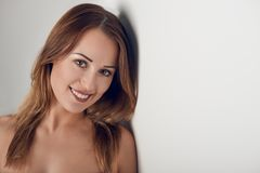 Young woman with pretty smile looking at camera Stock Images