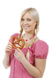 Young woman with pretzel Royalty Free Stock Photos