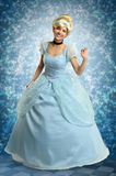 Young Woman in Princess Outfit. Portrait of beautiful woman dressed in princess costume over magical background stock image