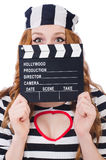 Young woman-prisoner with movie board Stock Photo