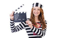 Young woman-prisoner with movie board isolated Stock Images