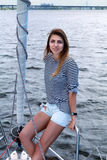 Young woman on private yacht Stock Image