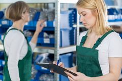 Young woman with product list Royalty Free Stock Images