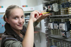 Young woman in professional electronics training Royalty Free Stock Photos