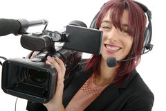 Young woman with a professional video camera. A beautiful young woman with a professional video camera and headphone Stock Images