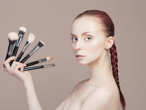 Young woman with professionals Brushes Royalty Free Stock Images
