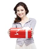 Young woman proffers a gift Royalty Free Stock Images