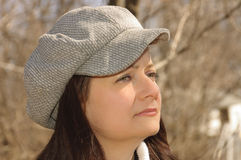 Young woman profile with a cap stock photography