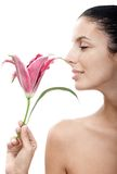 Young woman profile smelling lily Royalty Free Stock Photo