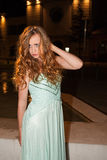 Young Woman in Prom Dress Posing Outdoors at Night Royalty Free Stock Photography