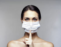Young woman with protecting mask Stock Photography