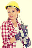 Young woman in protective helmet and jackhammer. Stock Photos