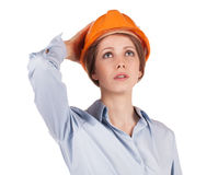Woman in a protective helmet looking up Royalty Free Stock Photos