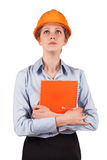 Woman in a protective helmet looking up Stock Photo
