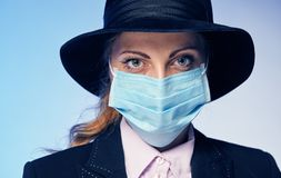 Young woman in a protective mask. She protects herself Royalty Free Stock Image