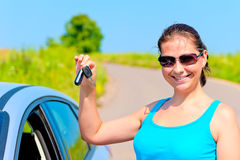Young woman proudly displays  the keys to her new car Royalty Free Stock Photos