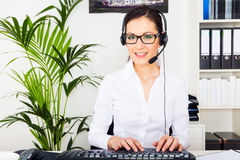Young Woman Providing It Support Royalty Free Stock Photography