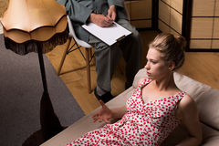 Young woman during psychotherapeutic session. Young women during psychotherapeutic session in private office Royalty Free Stock Photos