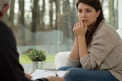 Young woman on psychotherapy session Stock Photos