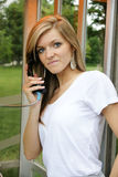Young woman in public phone Royalty Free Stock Images