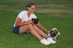 Young woman and pug dogs Royalty Free Stock Images