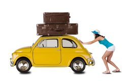 Young woman pulling car with suitcases Stock Photography