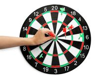 Young woman pulling dart out of board on white, top view. Young woman pulling dart out of board on white background, top view royalty free stock photo