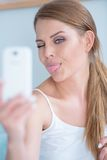 Young woman pulling a face for selfie Royalty Free Stock Images