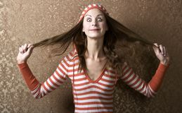 Young Woman Pulling on her Long Hair Stock Images