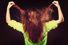 Young woman pulling her long hair. Stock Photo