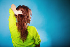 Young woman pulling her long hair. Stock Image