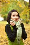 Young woman pulling her scarf Royalty Free Stock Images