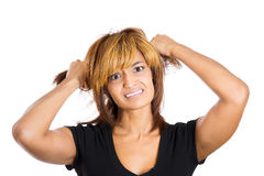 Young woman pulling out her hair in anger Royalty Free Stock Photo